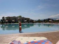 Hotelpool Tancau Village Beach and Ressort Fotos und Bilder